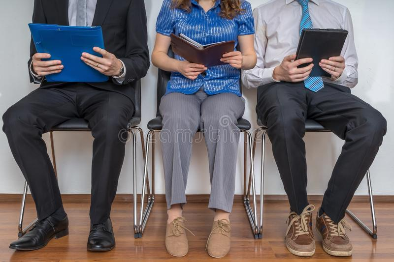 Group of people waiting for interview in a waiting room. Group of people waiting for interview in a waiting room royalty free stock image