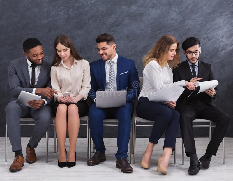 Group of people waiting for job interview royalty free stock image