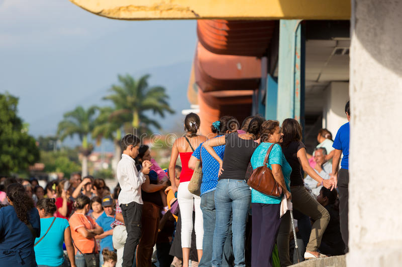 Group of people waiting in line at a public supermarket in Merida, Venezuela. stock image