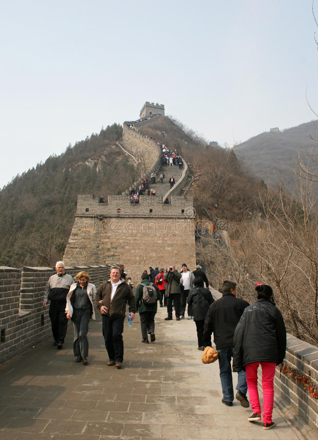 A group of people walking along BaDaling section of the great wall Beijing royalty free stock image