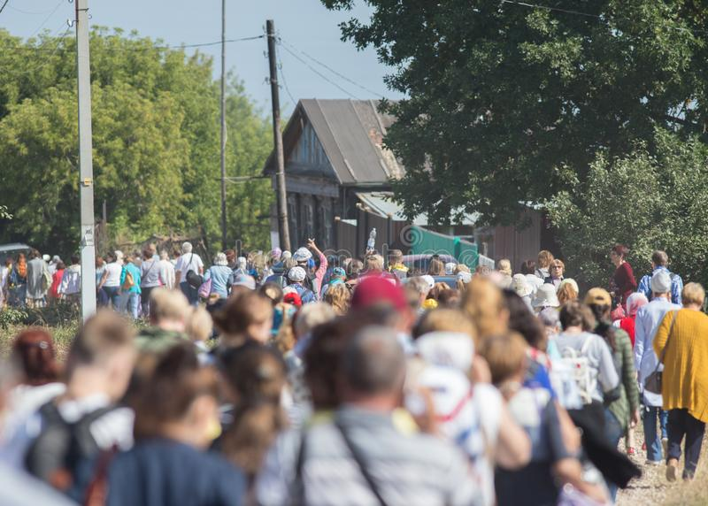 Group of people walking around the village, going down the road royalty free stock photos