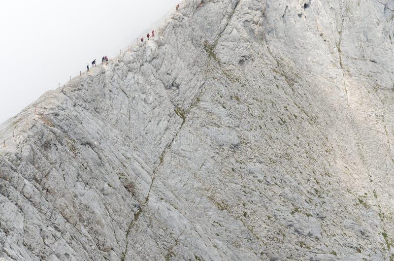 Group of people walking on the edge of Koncheto ridge stock photo