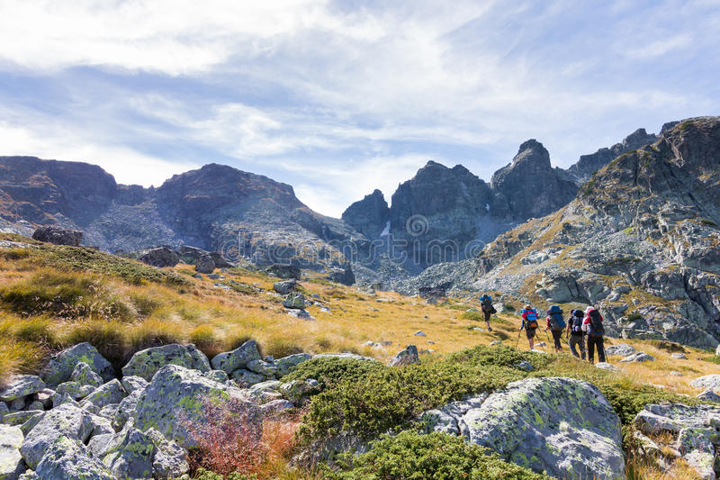 Group of people walking mountains. royalty free stock images