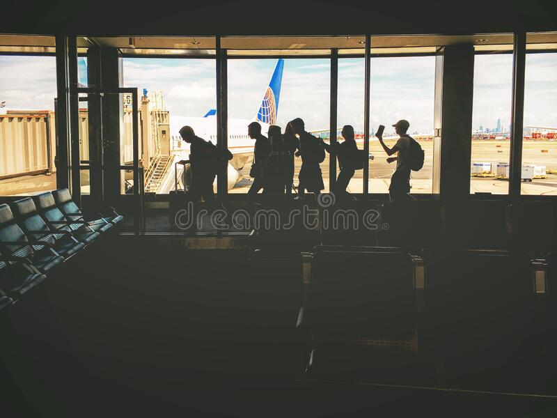 Group of People Walking Near Clear Glass Window With a View of White Airplane Parked during Daytime royalty free stock photos
