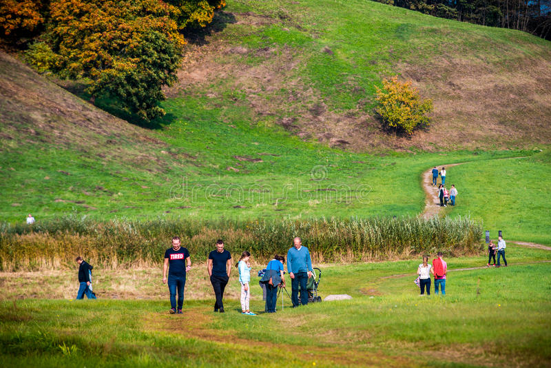 Group of people walking near Kernave hills royalty free stock image