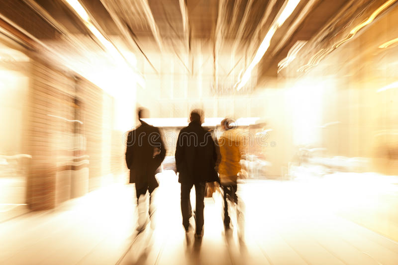 Group of People Walking in Shopping Centre, Motion Blur stock image