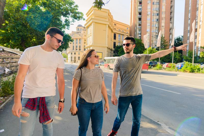 GROUP OF PEOPLE WALKING TOGETHER. OUTDOOR stock photos