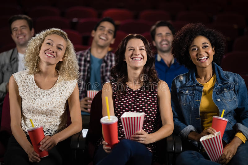 Group of people watching movie stock photography