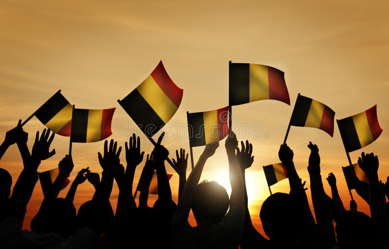 Group of People Waving Belgian Flags in Back Lit royalty free stock photo
