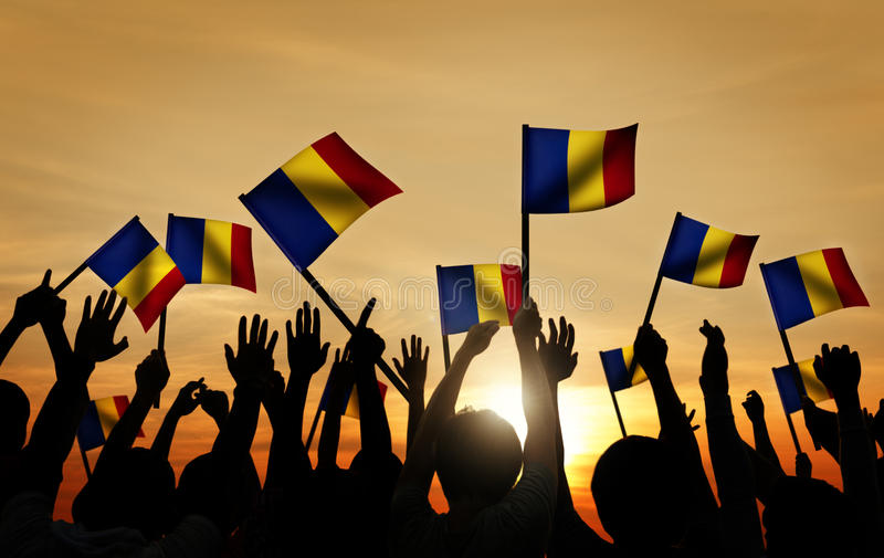 Group of People Waving Romanian Flags in Back Lit.  royalty free stock photography