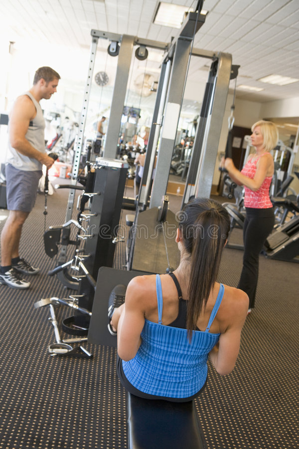 Group Of People Weight Training At Gym.  royalty free stock images