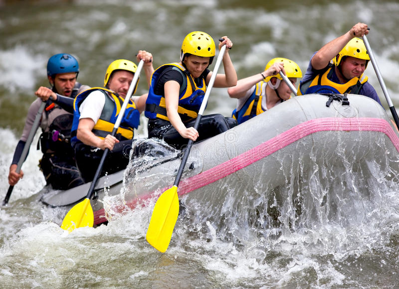 Group of people whitewater rafting stock photos