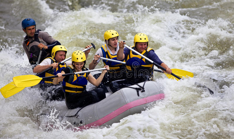 Group of people whitewater rafting royalty free stock image