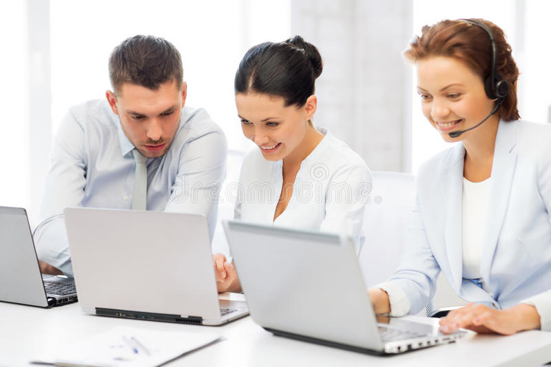 Group of people working with laptops in office royalty free stock photos