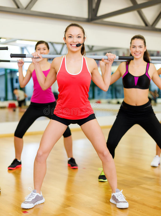 Group Of People Working Out With Barbells Stock Image