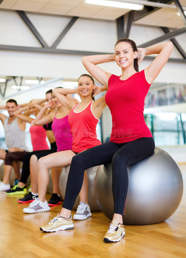 Group of people working out in pilates class royalty free stock photos