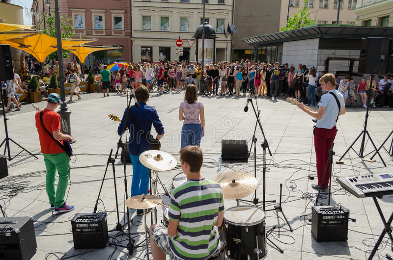 Group perform on street and people listen concert stock photo
