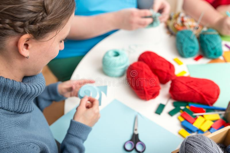 A group of persons doing handicrafts. A group of young persons doing handicrafts stock photography