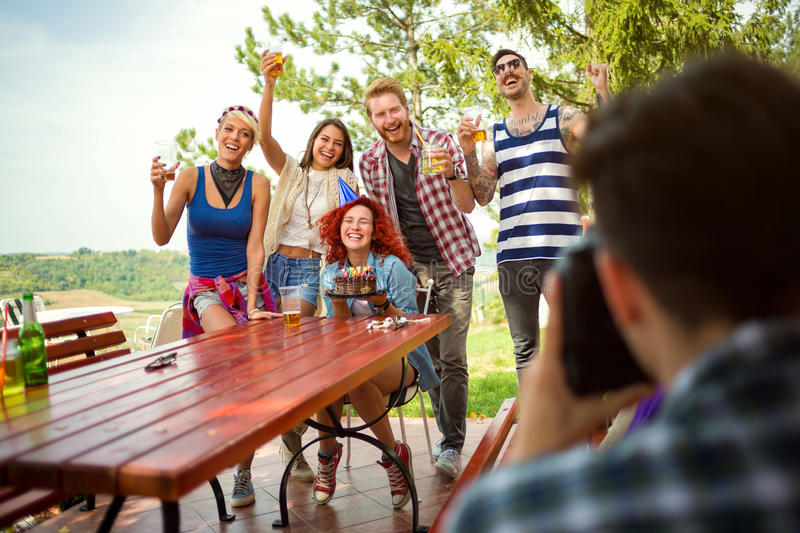 Group photo with birthday girl and friends with raise glasses stock photography