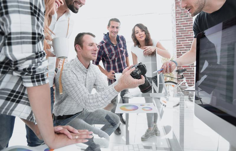 Group photo of editors working in a modern office. Concept of teamwork stock photography