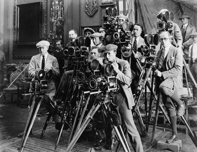 Group of photographers taking picture with cameras. (All persons depicted are no longer living and no estate exists. Supplier grants that there will be no model stock photos