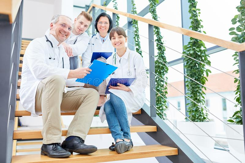 Group of physicians as team of doctors. In successful apprenticeship stock photography