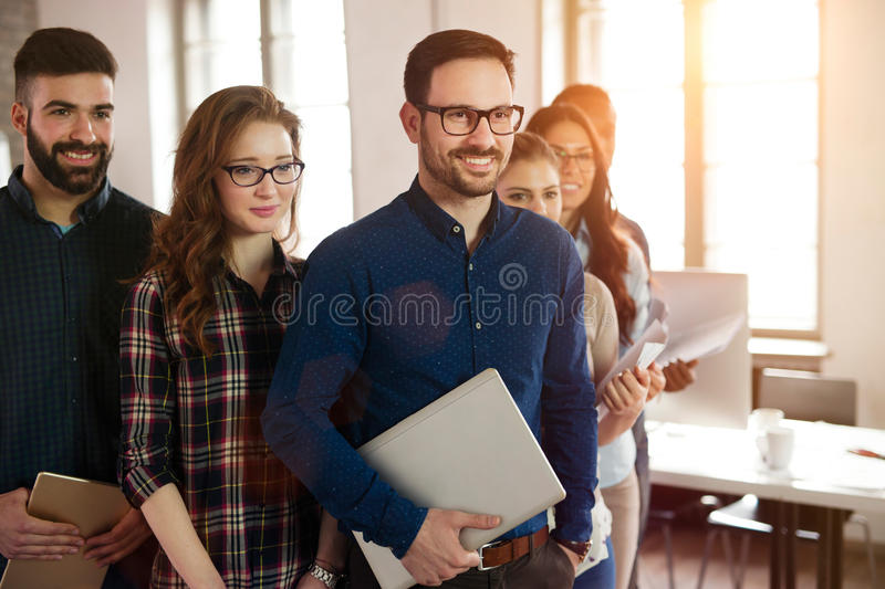 Group picture of team of successful and confident designers royalty free stock photos