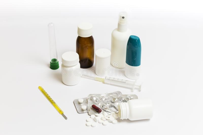Group of pills and medicine bottles. Group of pills, medicine cans, spray, syrups and syringes on a white background stock photography