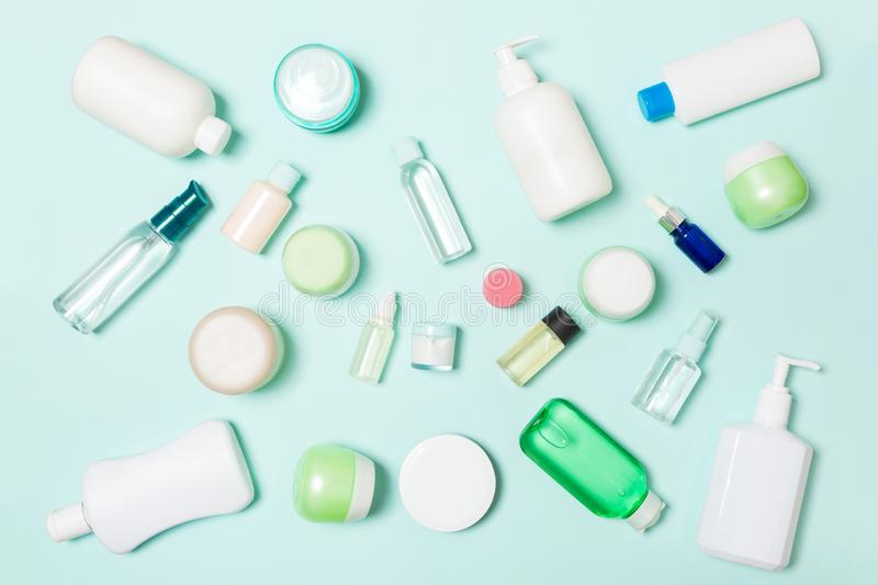 Group of plastic bodycare bottle Flat lay composition with cosmetic products on blue background empty space for you design. Set of royalty free stock images