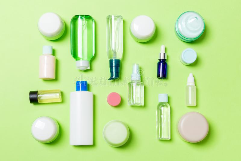 Group of plastic bodycare bottle Flat lay composition with cosmetic products on green background empty space for you design. Set stock images