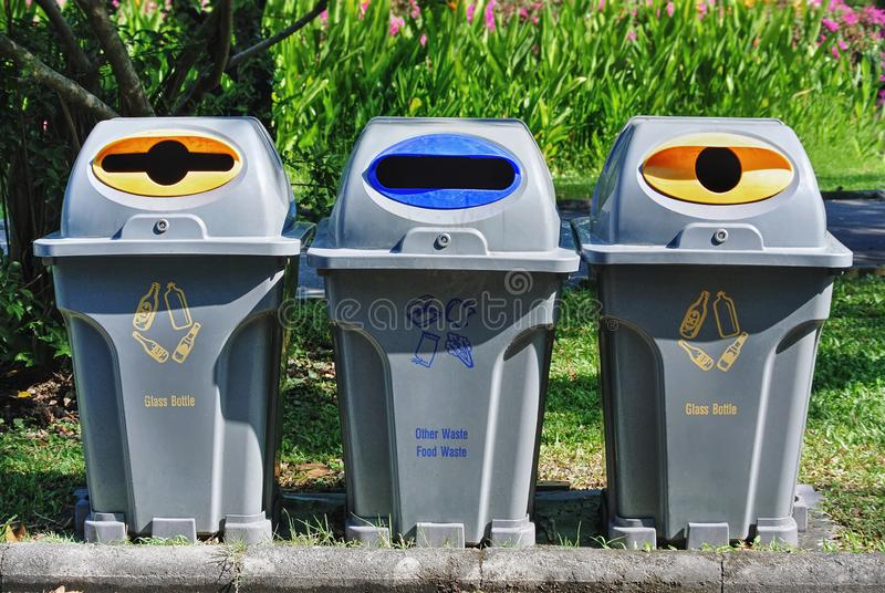 Plastic Trash Bins with Different Types of Waste for Recycle. Group of Plastic Trash Bins with Different Types of Waste for Recycle stock photography