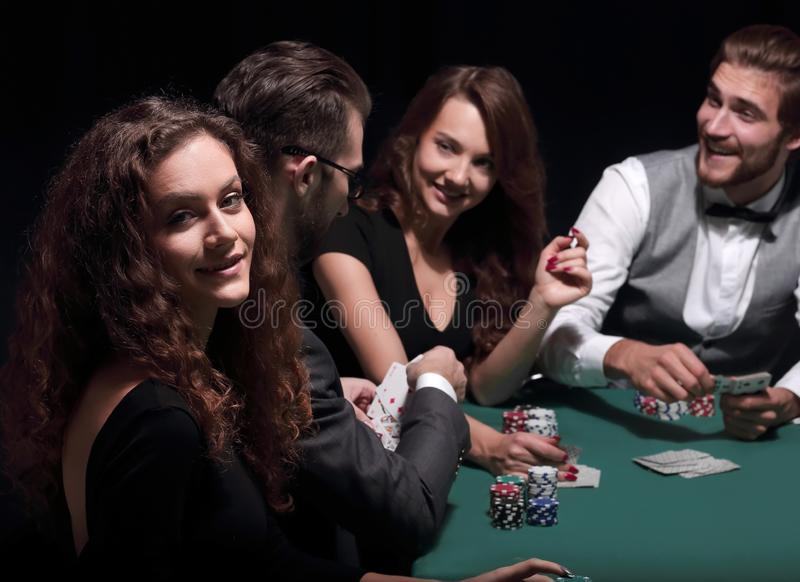 Players sitting at the playing table in the casino royalty free stock images