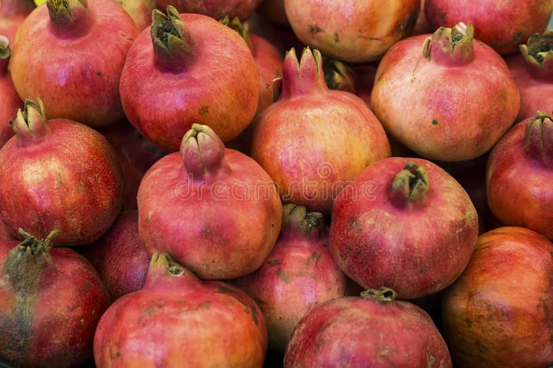 Group of pomegranates. Pomegranate closeup, background stock images