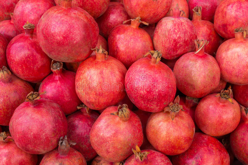 Group of pomegranates. Pomegranate closeup stock photography