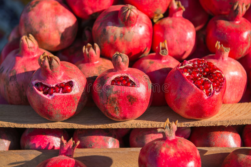 Group of pomegranates. Pomegranate closeup, background royalty free stock photography
