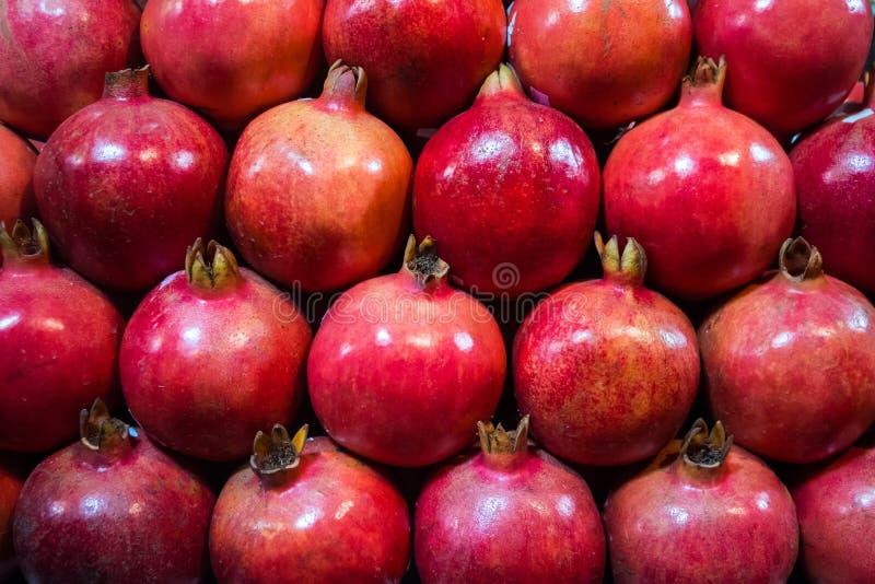 Group of pomegranates. Pomegranate closeup, background royalty free stock image