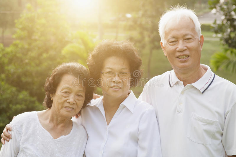 Group portrait of Asian seniors. Portrait group of healthy Asian seniors having activities at outdoor nature park, in morning beautiful sunlight at background royalty free stock photos