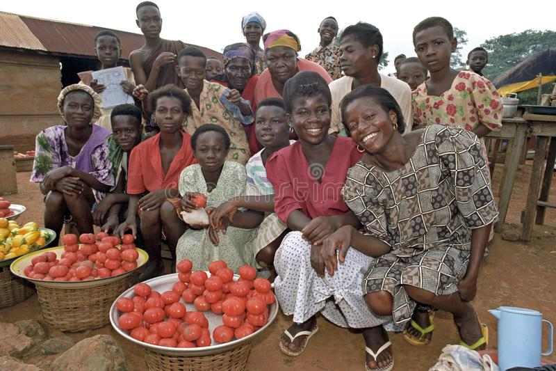 Group portrait female market vendors in Ghana. Ghana, village Forikrom: Ghanaian women enjoy the making of a group portrait on the market. Their workings place royalty free stock images