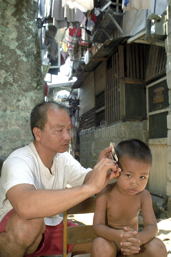 Group portrait Filipino father, the barber, and son stock image