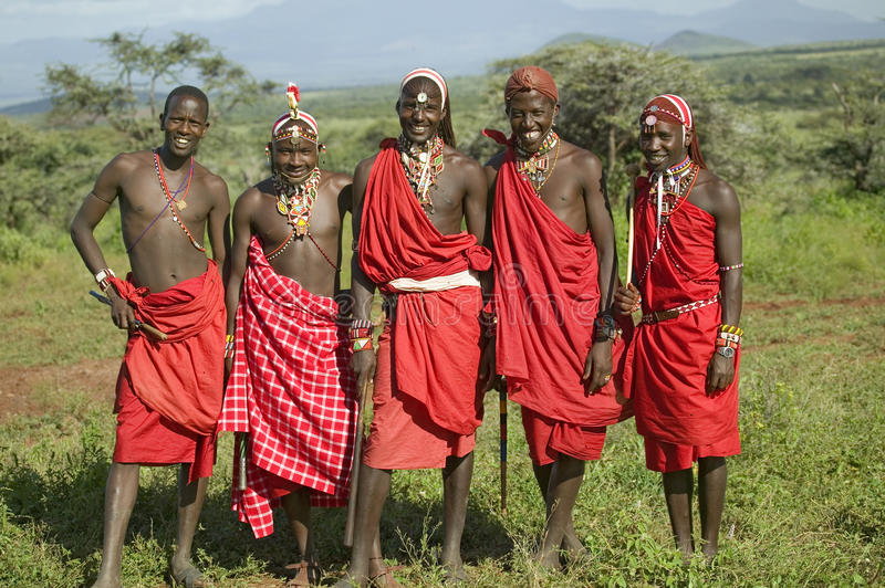 Group portrait of five Masai Warriors in traditional red toga at Lewa Wildlife Conservancy in North Kenya, Africa stock image