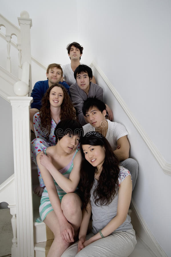 Group portrait of friends sitting in stairway stock images