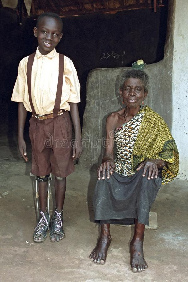 Group portrait of Ghanaian grandma and grandchild. Ghana, Region Brong Ahafo, village Kamampa: portrait of proud old woman with grandchild. The boy, child, is stock photos