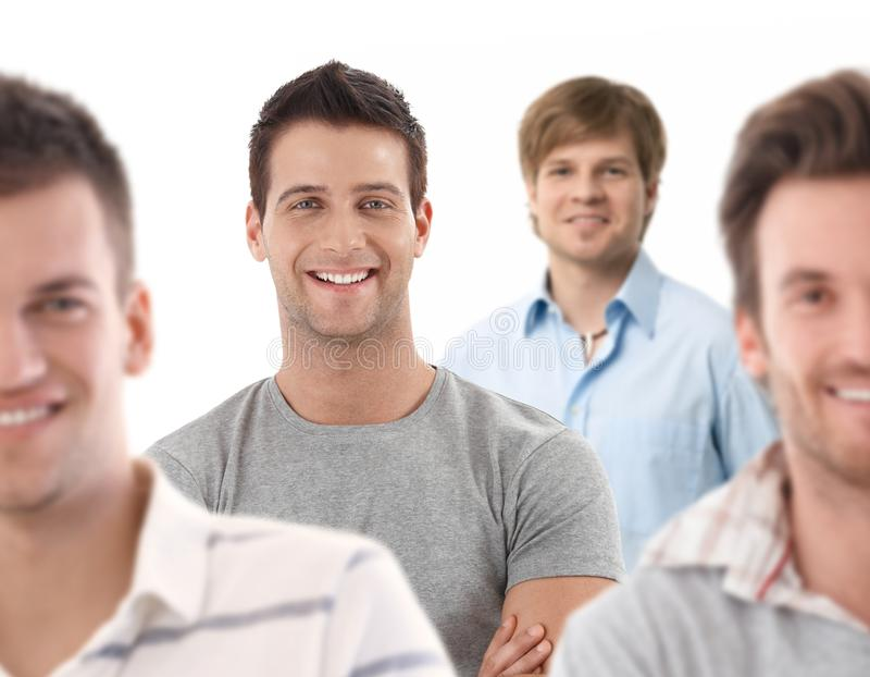 Group portrait of happy young men stock photography