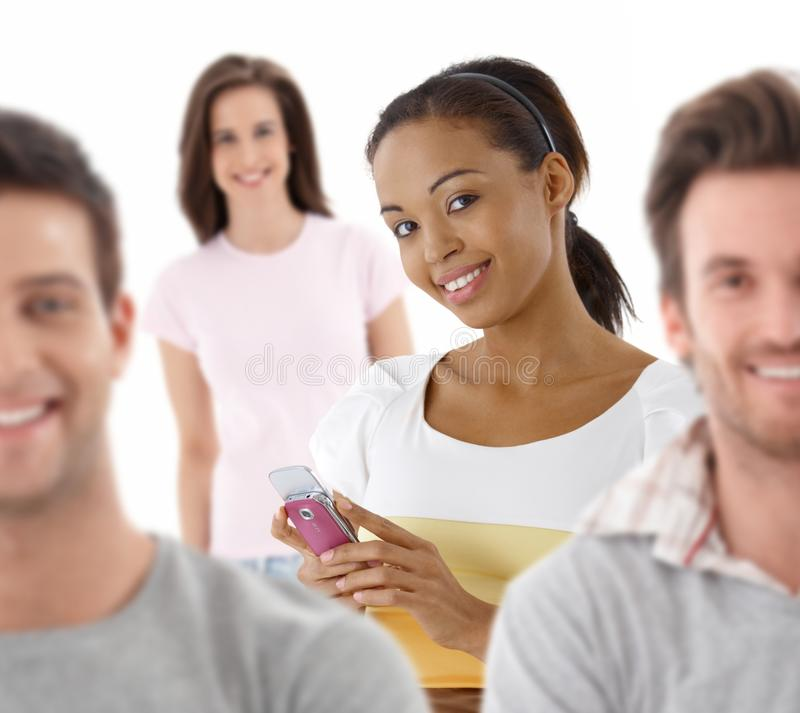 Group portrait of happy young people. Together, looking at camera, smiling royalty free stock photo
