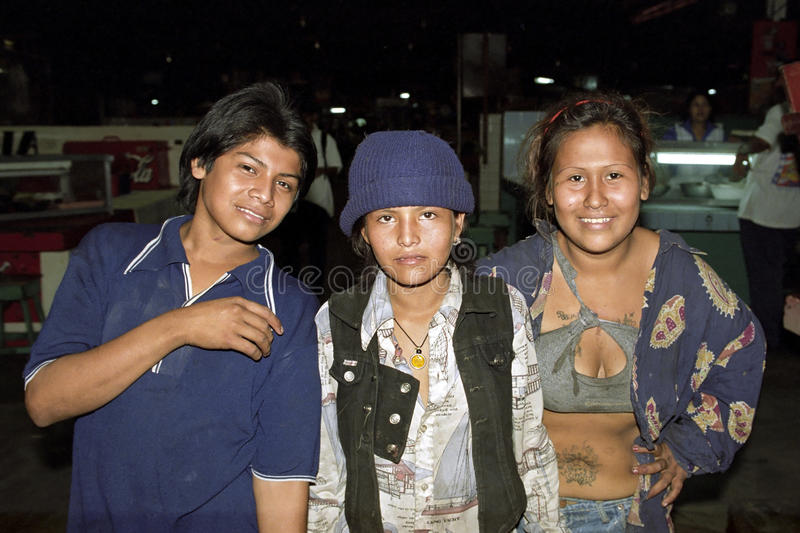 Group portrait of Latino, Nicaraguan, street children. Nicaragua, capital, city Managua: close-up of kids who roam in the dark covered part of the market square stock image