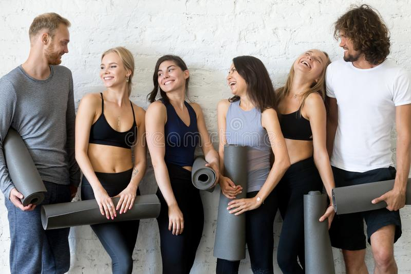 Group portrait of laughing sporty people yoga lesson royalty free stock photo