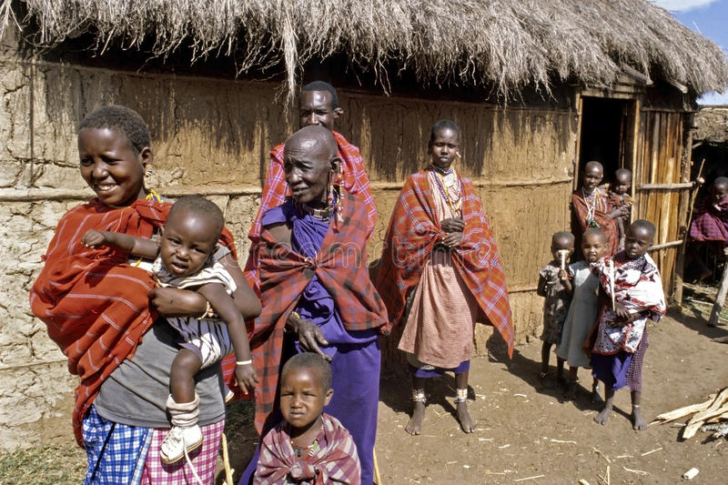 Group portrait of Maasai extended Family, Kenya. Kenya, village Kirtilikini: family photo of Masai grandmother with daughter and grandchildren infront of her stock photography
