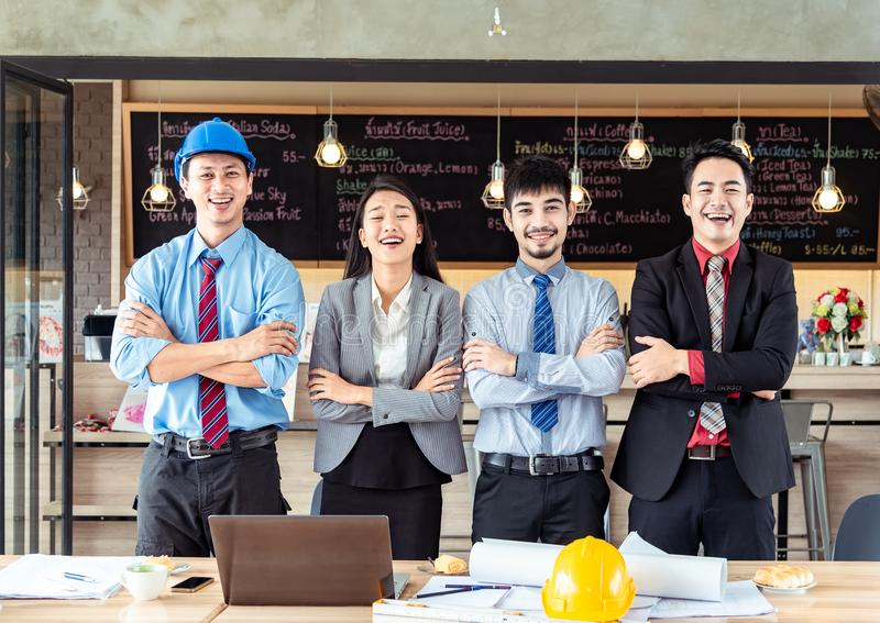 Group of Portrait of Successful confident young creative asian business team standing with arms crossed together in coffee shop . stock images
