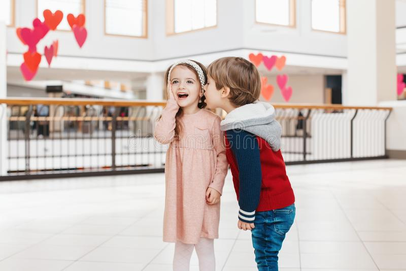 two white Caucasian cute adorable funny children boy and girl talking royalty free stock photography
