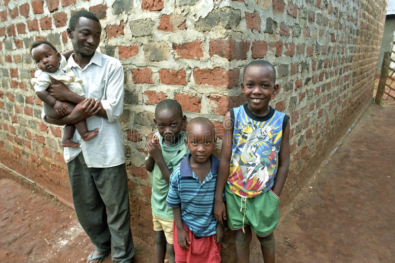 Group portrait Ugandan family, father and children stock images